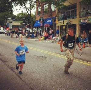 Marine helps boy finish race